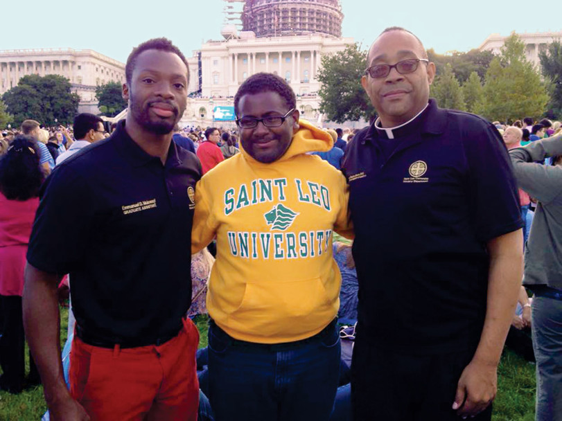 Below: Emmanuel D. Mulowayi, Joshua Bartholomew, and Father Stephan Brown in Washington, DC