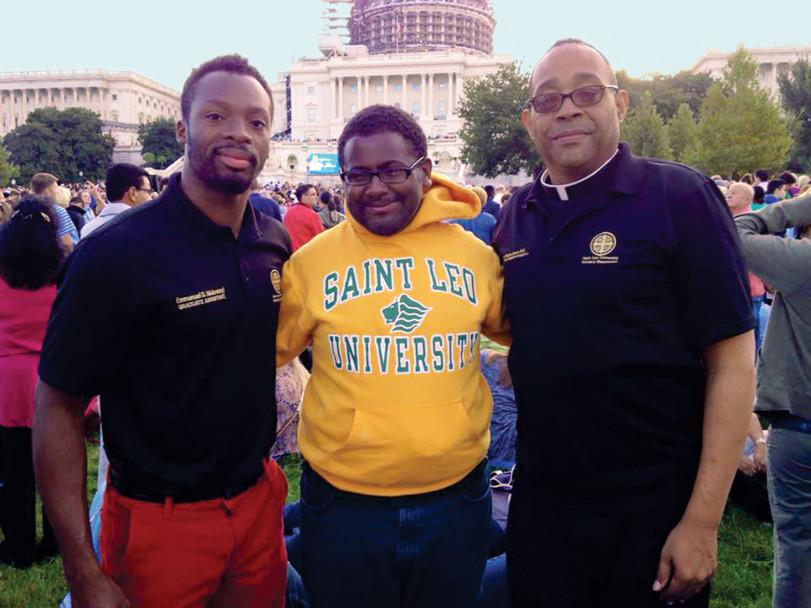 Below: Emmanuel D. Mulowayi, Joshua Bartholomew, and Father Stephan Brown in Washington, DC