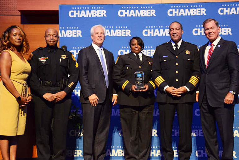 Norfolk Police Department Captain Michele Naughton receives a Community Heroes award from the Hampton Roads Chamber of Commerce
