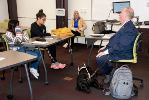 Michael Hingson talks to Saint Leo students with his guide dog, Alamo