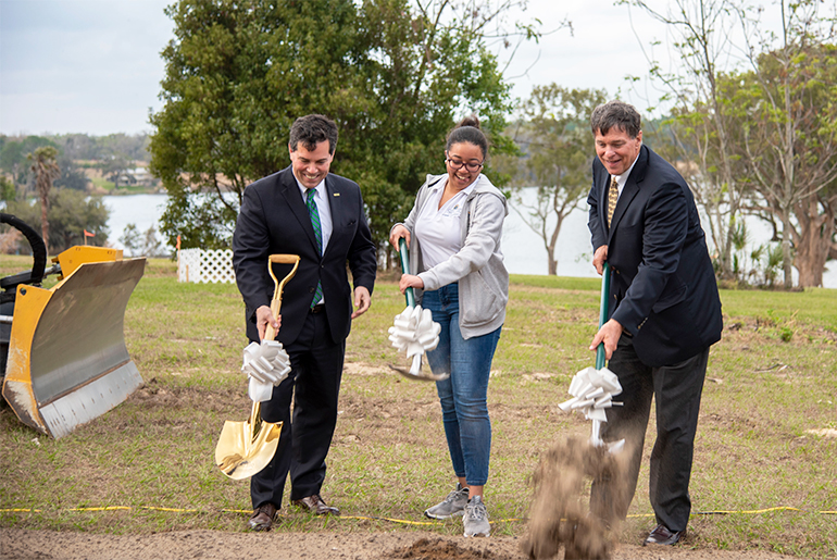 Dr. Jeffrey D. Senese, Saint Leo president; Celine-Deon Palmer, Student Government Union president 2019-2020; D. Dewey Mitchell, Saint Leo Board of Trustees chair, break grown for the Wellness Center.